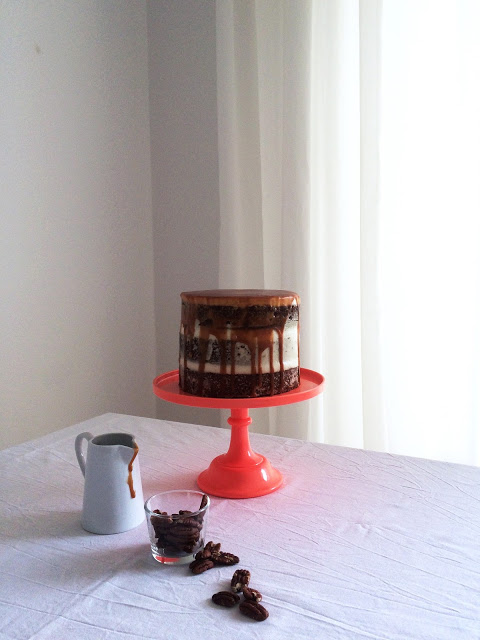 a birthday cake for prince charming. { semi-naked hummingbird cake with mascarpone frosting and toffee caramel sauce }