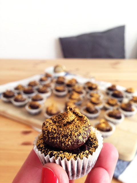 bite sized frosted babies with golden sparkles. { gluten-free vegan devil's food mini cupcakes }
